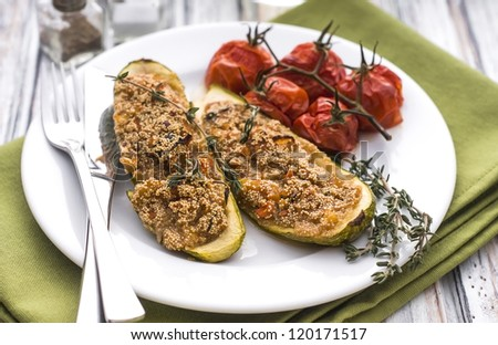 Stuffed zucchini with amaranth grain and vegetables - stock photo