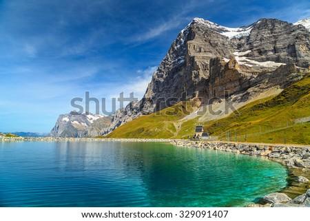 Stunning alpine lake with high mountains and famous peaks,Kleine Scheidegg,Bernese Oberland,Switzerland,Europe - stock photo