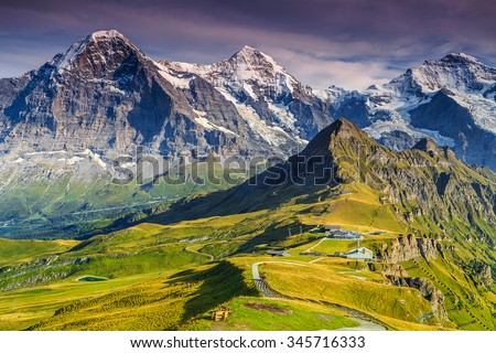 Stunning alpine panorama with Jungfrau,Monch,Eiger North face and Mannlichen cable car station,Grindelwald,Bernese Oberland,Switzerland,Europe - stock photo