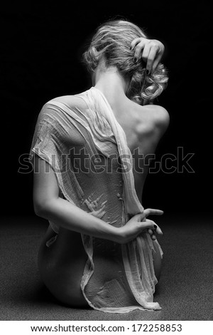 stunning beautiful young girl with perfect body posing naked and covering with long white wet material - stock photo