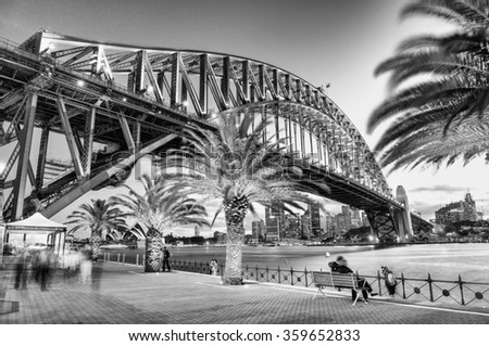 Stunning black and white night view of Sydney Harbour Bridge. - stock photo