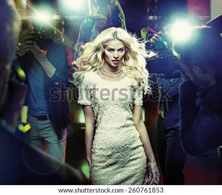 Stunning blonde beauty and press photographers - stock photo