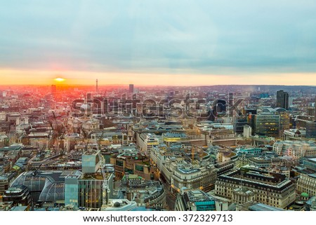 Stunning city sunset sunrise in London from one of the skyscrapers in sky garden  - stock photo