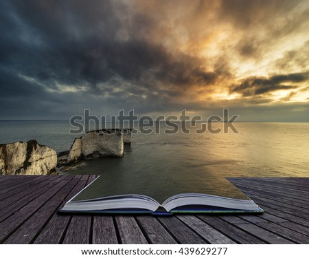 Stunning cliff formation landscape during beautiful sunrise with book morphing into sea - stock photo