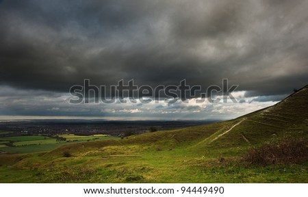 Stunning cloud formations during stormy sky over countryside landscape with vibrant colors - stock photo