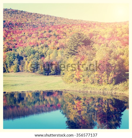 Stunning fall foliage and lake in Vermont, USA, with Instagram effect filter - stock photo