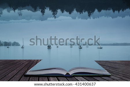 Stunning impossible enigmatic conceptual landscape image of lake and forest opposite each other vertically - stock photo