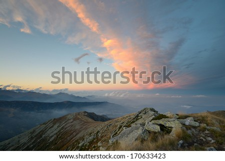 Stunning landscape and romantic cloudscape at sunset in the italian Alps - stock photo