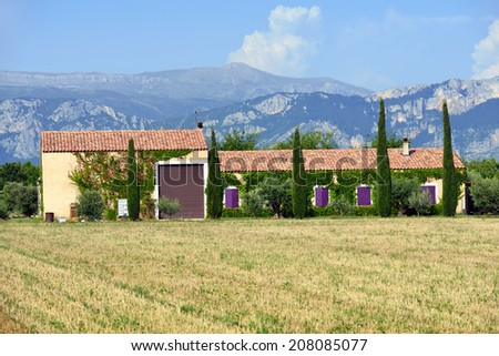 Stunning landscape with  field and old farmhouse at evening. Plateau of Valensole, Provence, France - stock photo