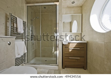 stunning modern en-suite bathroom with shower cabin - stock photo