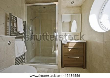 stunning modern en-suite bathroom with shower cabin - stock photo