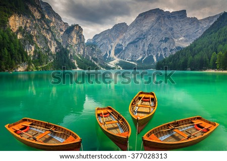 Stunning romantic place with typical wooden boats on the alpine lake,(Lago di Braies) Braies lake,Dolomites,South Tyrol,Italy,Europe - stock photo