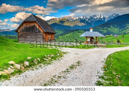 Stunning rural farm with old wooden hut and oven,Bran,Transylvania,Romania,Europe - stock photo