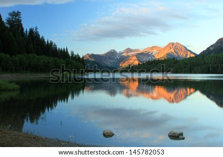 Stunning summer landscape with Mt. Timpanogos reflecting in Silver lake, Utah, USA. - stock photo