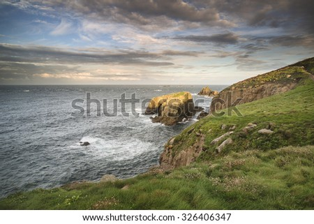 Stunning sunrise landscape of Land's End in Cornwall England - stock photo