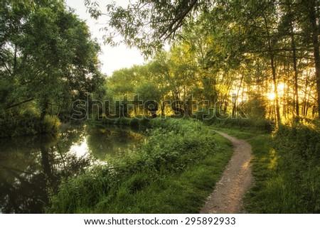 Stunning sunrise landscape over river on Summer morning - stock photo