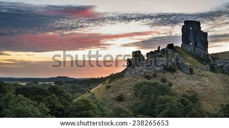Stunning sunrise landscape over ruins of medieval castle - stock photo