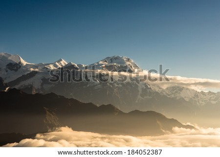 Stunning sunrise over the Annapurna mountain range capture from a micro-light plane in Nepal.  - stock photo