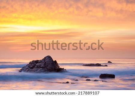 Stunning sunset on the beach at Sandymouth near Bude North Cornwall England UK Europe - stock photo