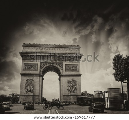 Stunning sunset over Arc de Triomphe in Paris. Triumph Arc Landmark. - stock photo