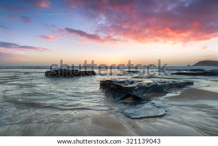 Stunning sunset over rocks at Booby's Bay on the north Cornwall coast - stock photo