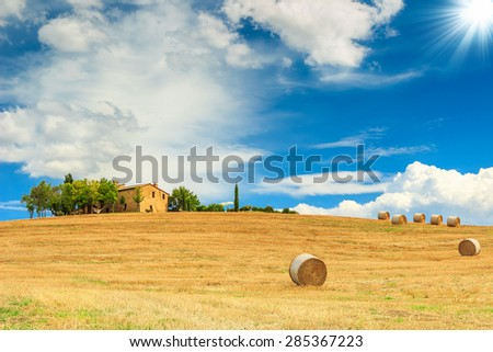 Stunning Tuscany landscape,typical stone house and hay bale on the hills,near Val d'Orcia,Italy,Europe - stock photo