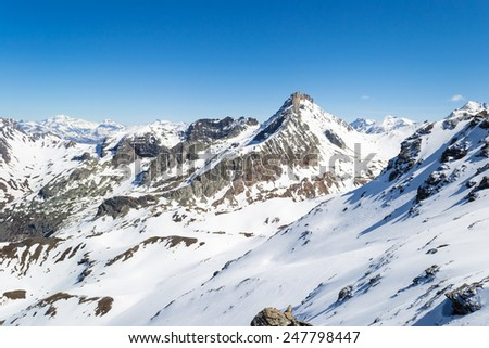 Stunning view of elegant mountain peak arising from the alpine arc in late winter season and beginning of spring. Valleys once covered by thick glacier. Torino Province on Italy France border. - stock photo