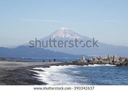 Stunning view of Fuji mountain from Miho no Matsubara Beach,Shizuoka,Japan, in soft blue sky with Haze and smoke effect at the mountain. - stock photo