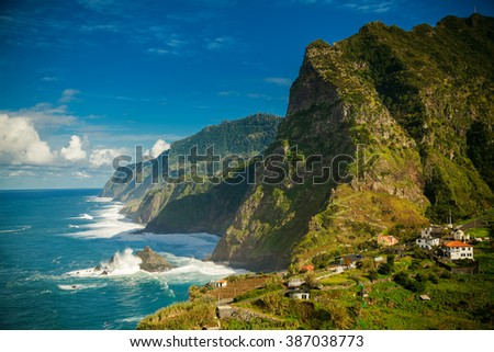 stunning view of rocky mountains and ocean on the northern coast of Madeira near Boaventura - stock photo