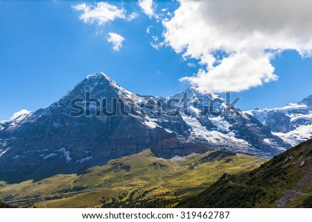 Stunning view of the famous Eiger north face and the Eiger glacier on a summer day, swiss alps on Bernese Oberland of Switzerland. - stock photo