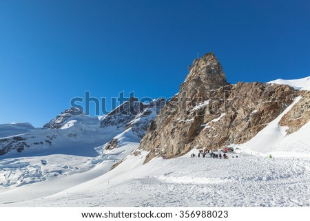 Stunning view of the famous peak  Jungfrau of swiss Alpsand  and the Sphinx Observatory, ne of the highest astronomical observatories in the world, from Jungfraujoch on Bernese Oberland, Switzerland. - stock photo