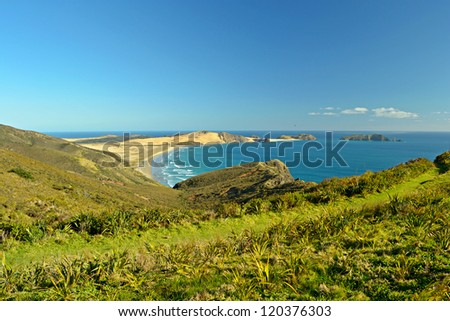 Stunning view of the Tasman Sea from the headland of Cape Reinga in a bright winter day, New Zealand Northern Island. Here begins the famous Ninety Mile Beach, aka Te Oneroa-a-Tohe in Maori language. - stock photo