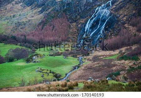 Stunning Waterfall In Irish Wilderness - stock photo