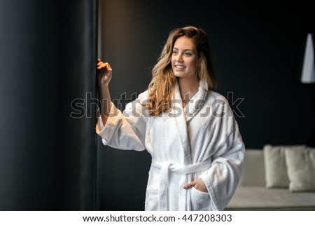 Stunning woman in bathrobe enjoying wellness weekend - stock photo