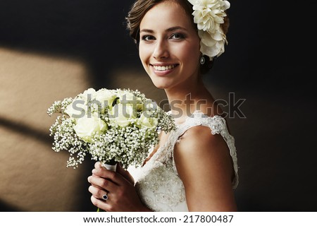 Stunning young bride holding bouquet, portrait  - stock photo