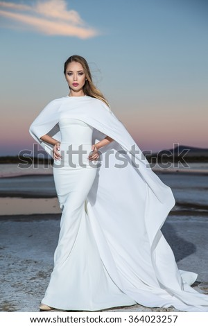 Stunning young woman in white dress  - stock photo