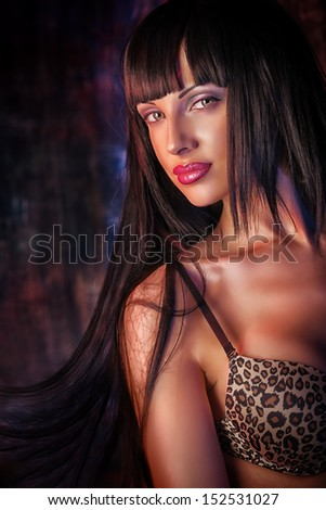 Stunningly sexy girl posing in the old garage.  - stock photo