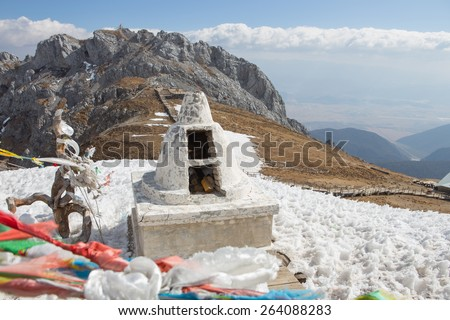 Stupa for burning prayer paper at highest mountain Blue moon valley mountain  Shangri-la China - stock photo