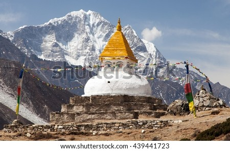 Stupa near Dingboche village with prayer flags and mounts Kangtega and Thamserku - way to mount Everest base camp - Khumbu valley - Nepal - stock photo
