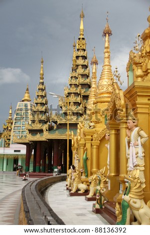 Stupas and temples on the base of Shwe Dagon pagoda in Yangon, Myanmar - stock photo