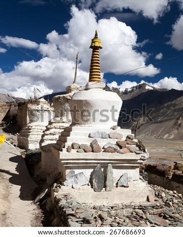 Stupas with beautiful clouds in Karsha gompa - buddhist monastery in Zanskar valley - Ladakh - Jammu and Kashmir - India  - stock photo