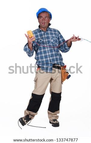 Stupid electrician - stock photo
