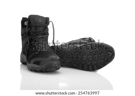 Sturdy shoes for hiking over rough terrain isolated on white background - stock photo
