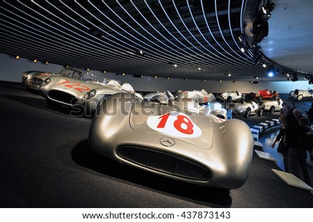 Stuttgart, Germany - April 22, 2014: Interior of a modern museum of Mercedes cars. Exposition of racing cars on a dark background. - stock photo