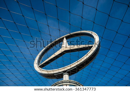 Stuttgart, Germany - December 28, 2015. The Mercedes Benz Star at the top of the sightseeing tower of the Main Train Station in Stuttgart. - stock photo