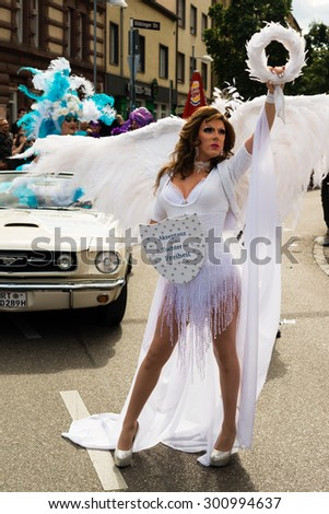 STUTTGART, GERMANY - JULY 25, 2015: A handsome man dressed as woman is presenting the motto of the Christopher Street Day 2015 in Stuttgart: Acceptance is the daughter of Liberty. The Christopher - stock photo