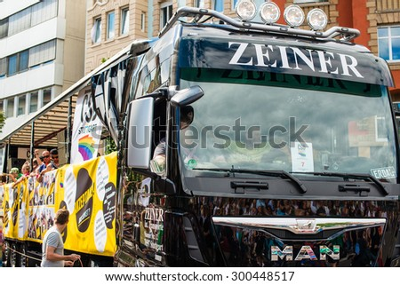STUTTGART, GERMANY - JULY 25, 2015: The gay and lesbian community is partying on a truck during Christopher Street Day 2015 in Stuttgart. The Christopher Street Day in Stuttgart is the largest gay parade - stock photo