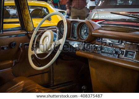 "STUTTGART, GERMANY - MARCH 18, 2016: Cabin of full-size luxury car Mercedes-Benz 280 SE 3.5 Coupe (W111), 1970. Europe's greatest classic car exhibition ""RETRO CLASSICS"" - stock photo"