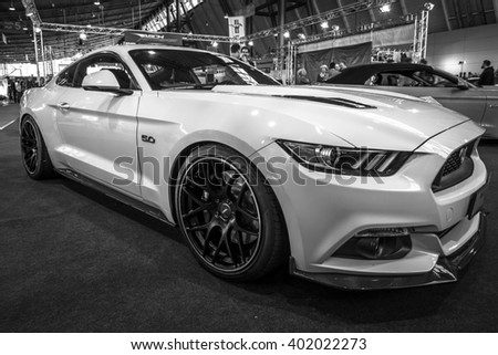 """STUTTGART, GERMANY - MARCH 17, 2016: Pony car Ford Mustang GT fastback coupe (sixth generation), 2015. Black and white. Europe's greatest classic car exhibition """"RETRO CLASSICS"""" - stock photo"""
