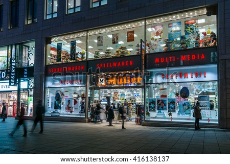 STUTTGART, GERMANY- MARCH 16, 2016: The historic shopping street in the central part of the city - Koenigstrasse (King Street), and a showcase well-known store Mueller. - stock photo